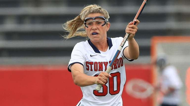 Stony Brook's Ally Kennedy passes the ball against