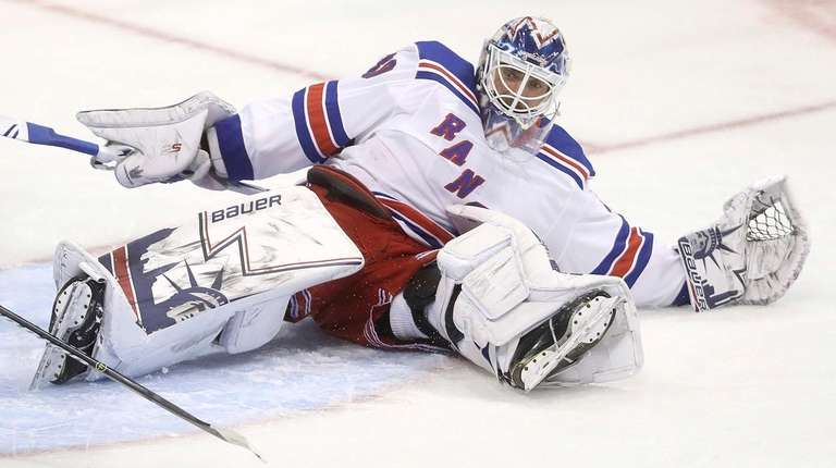 Rangers goaltender Henrik Lundqvist scrambles after making a