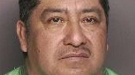 Celio Monroy-Huit, 48, of Riverhead, was charged with