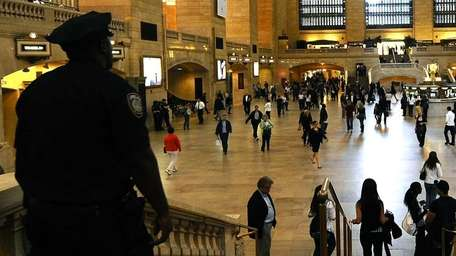 A Metropolitan Transportation Authority police officer keeps watch