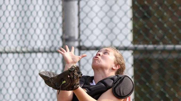 MacArthur's Kate McNamara makes a fine catch behind