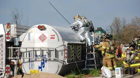 A gasoline tanker overturned about 2:15 p.m. Friday