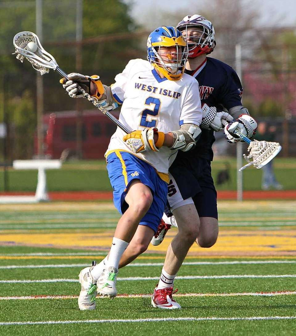 West Islip midfield Conner Bradish #2 drives to