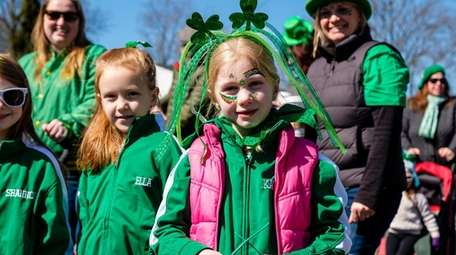 Kaitlyn Condon, 6, of Seaford, marches in Wantagh's