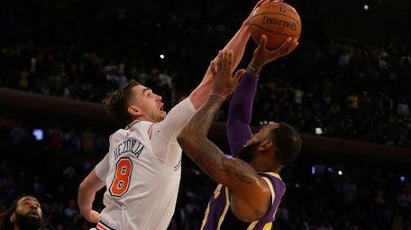 Mario Hezonja #8 of the Knicks blocks a