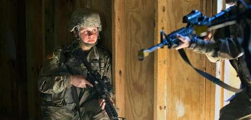 An Army recruit trains with her male counterparts