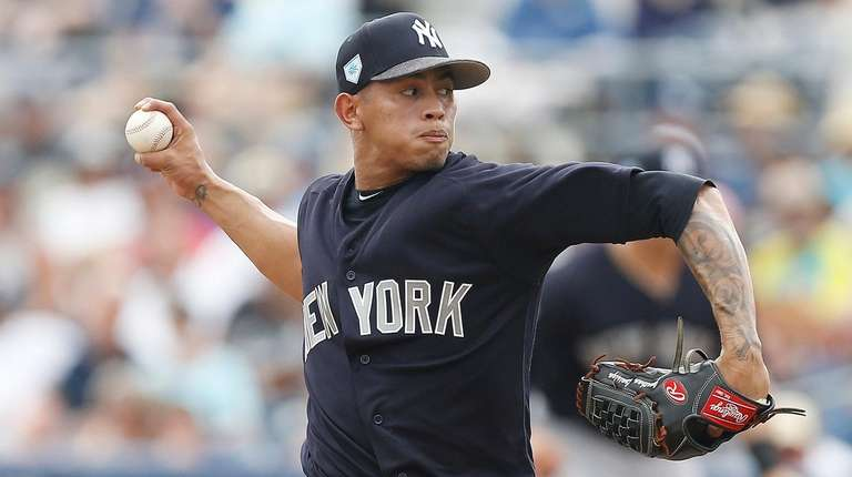Jonathan Loaisiga #67 of the Yankees delivers a