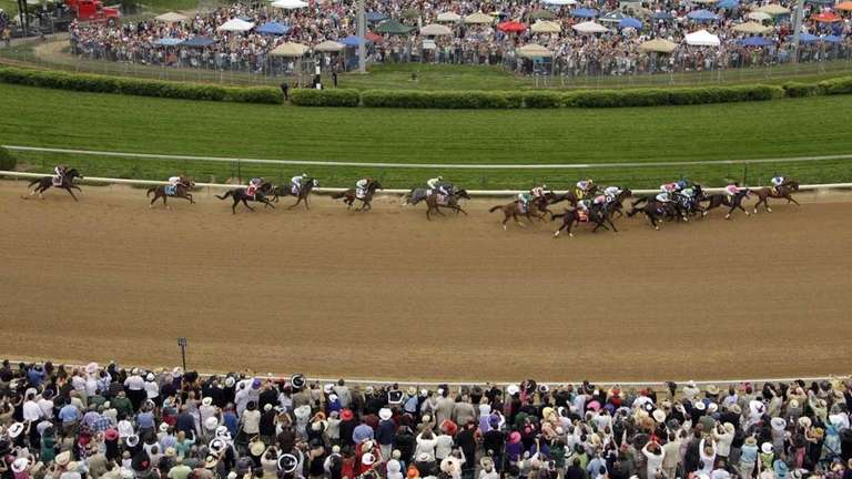 Horses go around the first turn during the