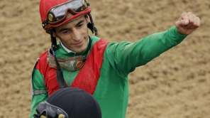 John Velazquez riding Animal Kingdom reacts after winning