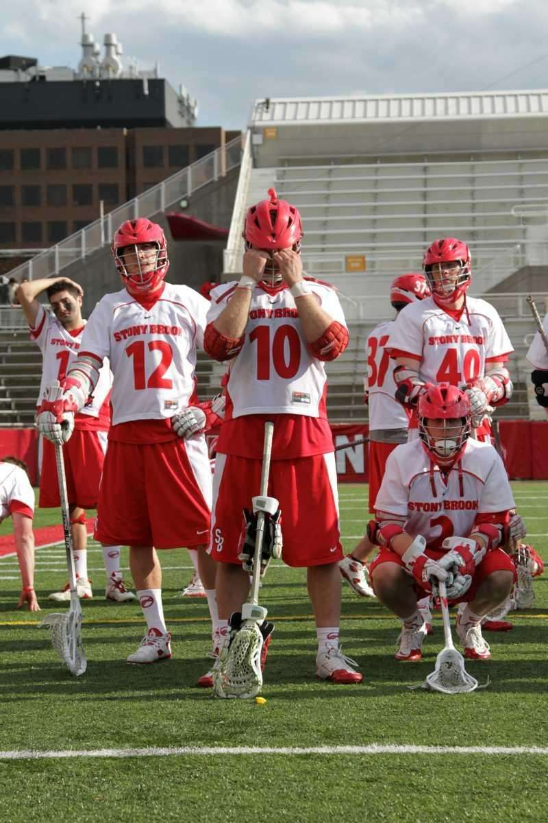 Stony Brook's #10 Adam Rand and teammates are
