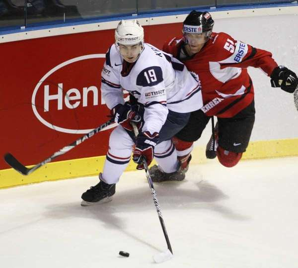 Chris Kreider, left, of the U.S. tries to