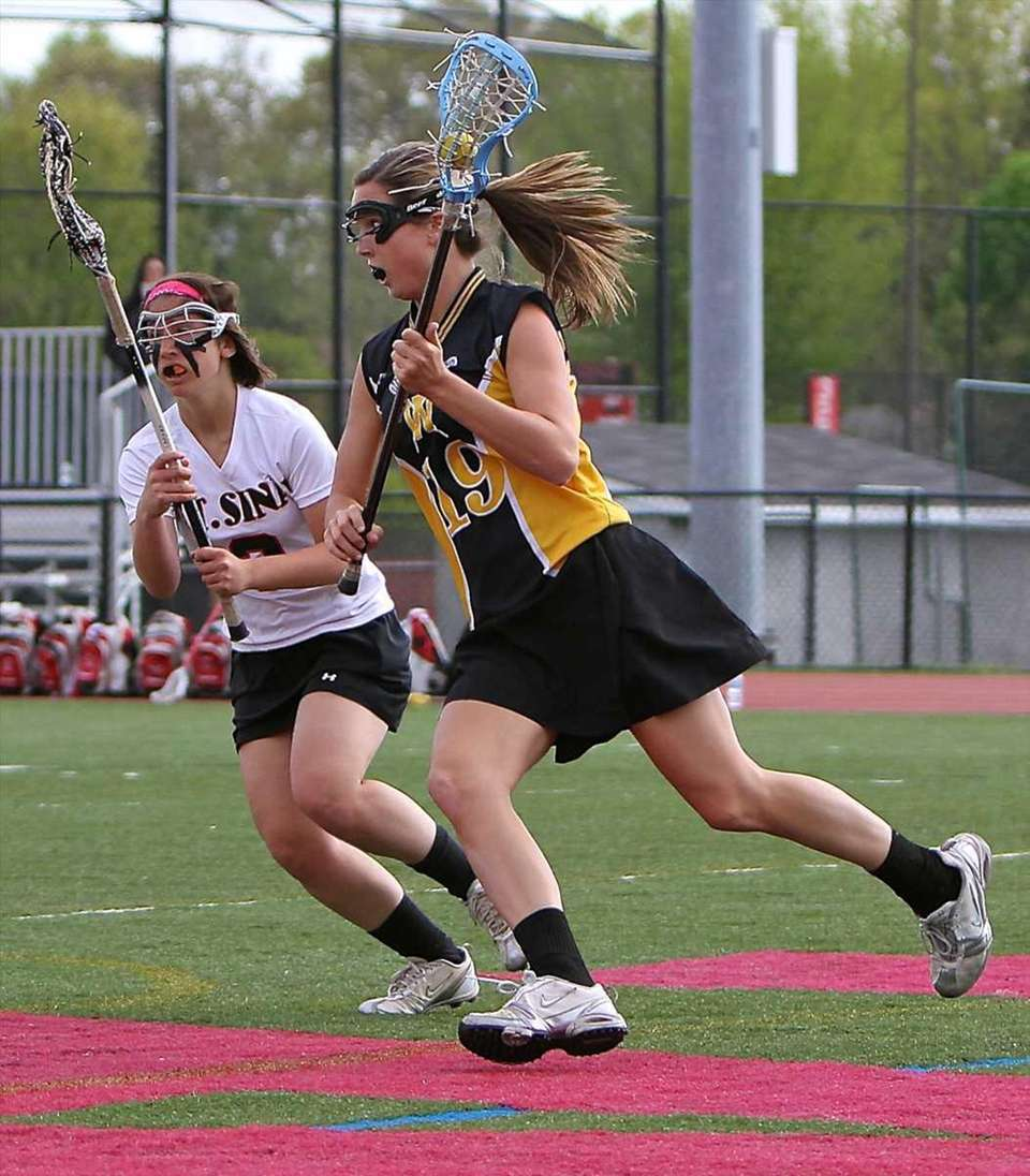 Wantagh attack Paula Schmidt #19, moves behind the