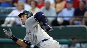 The Yankees' Derek Jeter hits a double against
