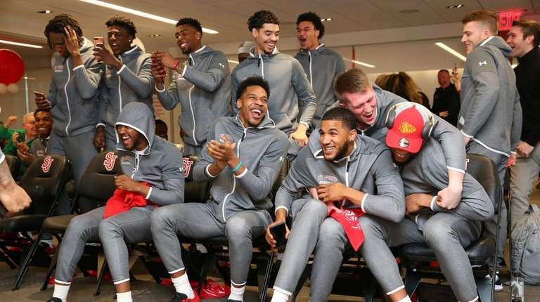 The St. John's men's basketball team celebrates after