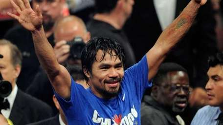 Manny Pacquiao celebrates his unanimous decision victory over
