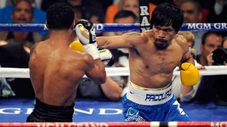 Manny Pacquiao throws a right at Shane Mosley