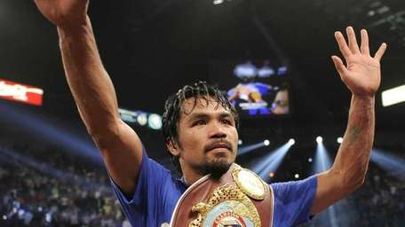 Manny Pacquiao celebrates after defeating Shane Mosley by