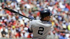 Yankees shortstop Derek Jeter hits a home run