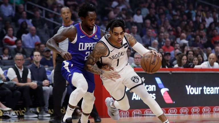 The Nets' D'Angelo Russell, right, drives around the