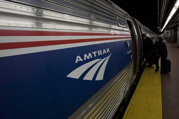 Passengers heading for the Amtrak train at Penn