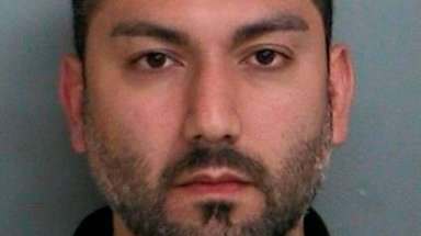 Arash Haghani, 38, of Farmingville, was arrested on
