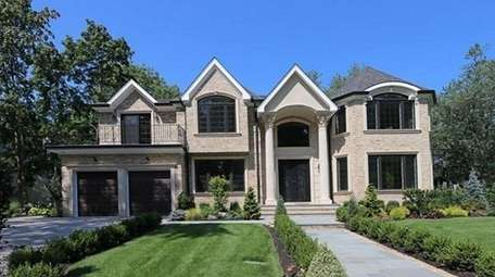 This Roslyn Heights Colonial, for $2,688,888, includes six