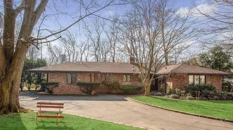 This Roslyn Heights expanded ranch, for $925,00, includes