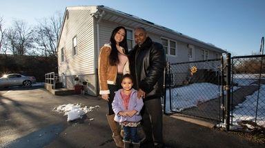 Celeste, Brenden and Celestina Burns outside their Holtsville