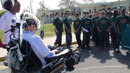 Christopher Pendergast faces a group of students from