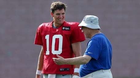 Giants general manager Dave Gettleman talks to quarterback