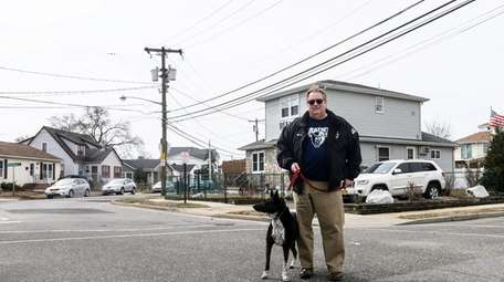 Island Park Mayor Michael McGinty with his dog