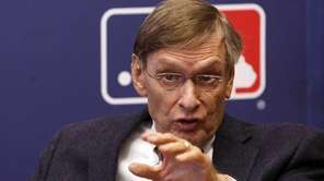 Major League Baseball commissioner Bud Selig gestures while