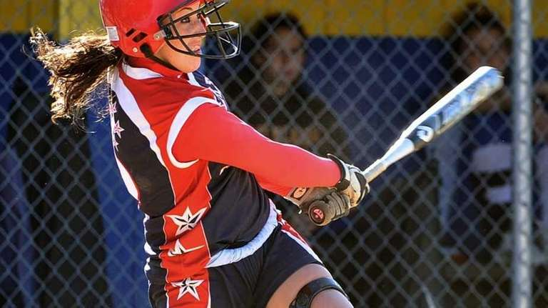 MacArthur's Kristen Brown watches her fly ball in