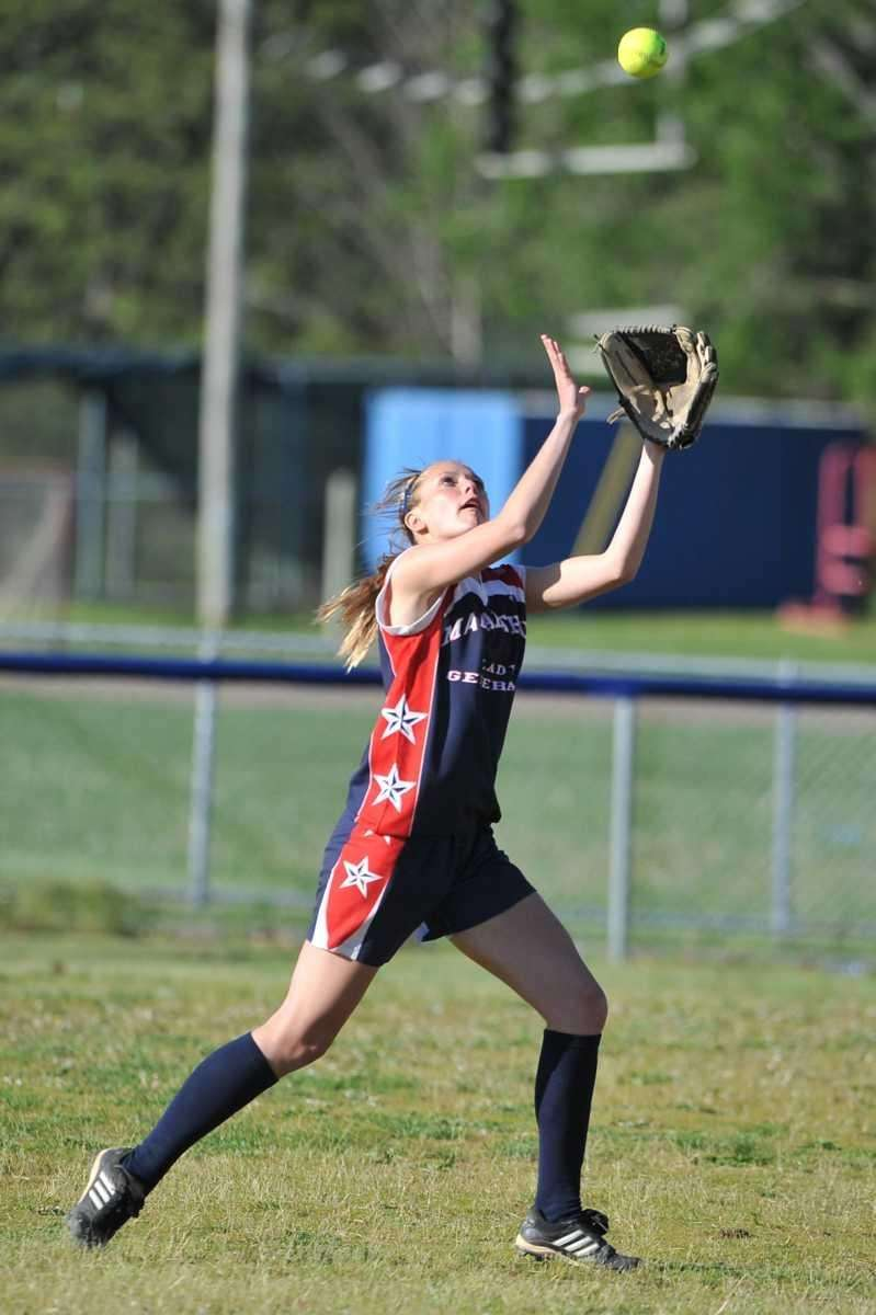 MacArthur center fielder Hayley Myles catches a fly