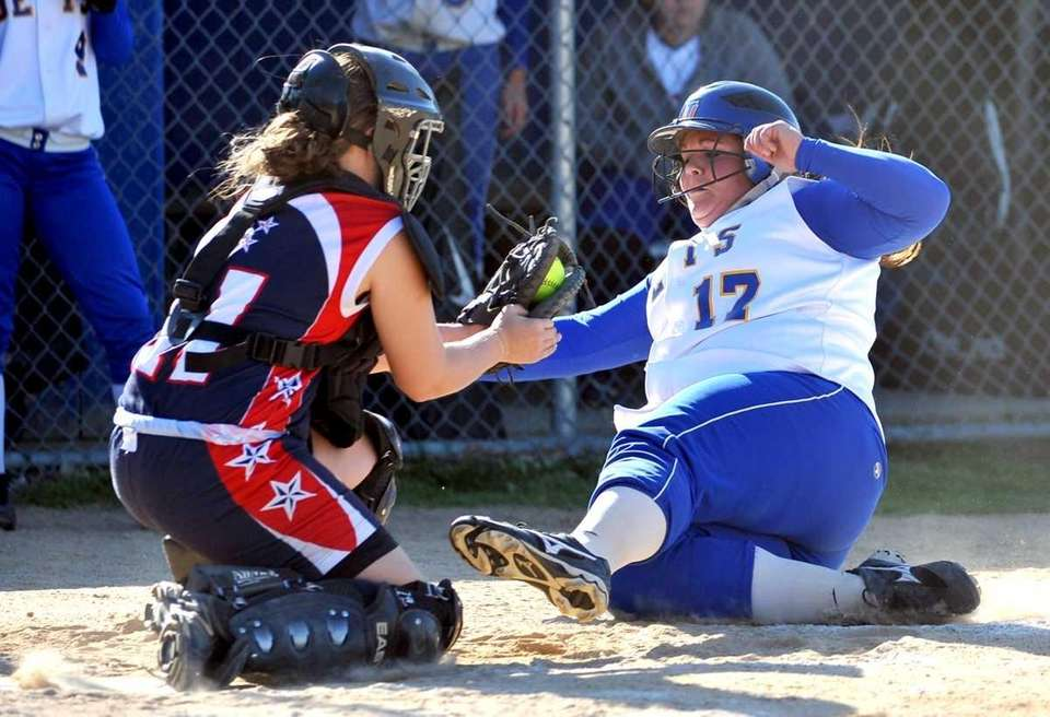 MacArthur's catcher Kate McNamara tags out East Meadow's
