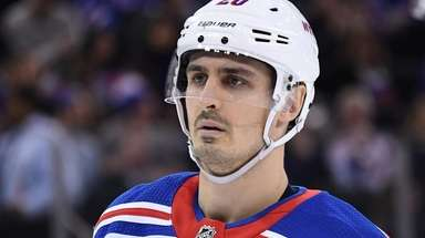 Rangers left wing Chris Kreider looks on against