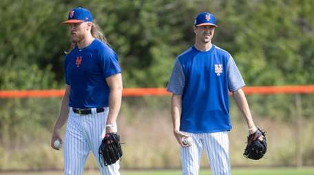 Mets pitchers Noah Syndergaard and Jacob deGrom during