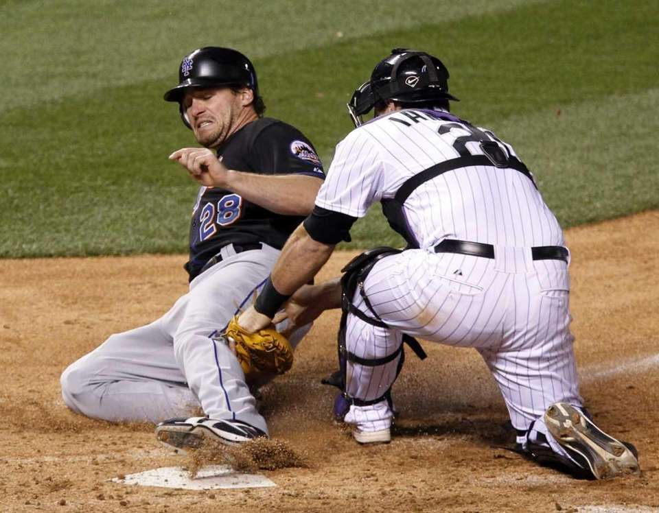The Mets' Daniel Murphy, left, is tagged out
