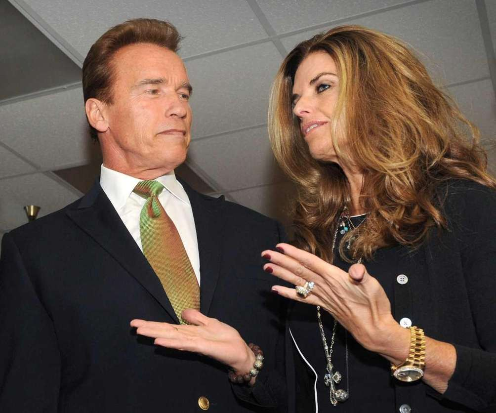 Arnold Schwarzenegger and his wife Maria Shriver attend