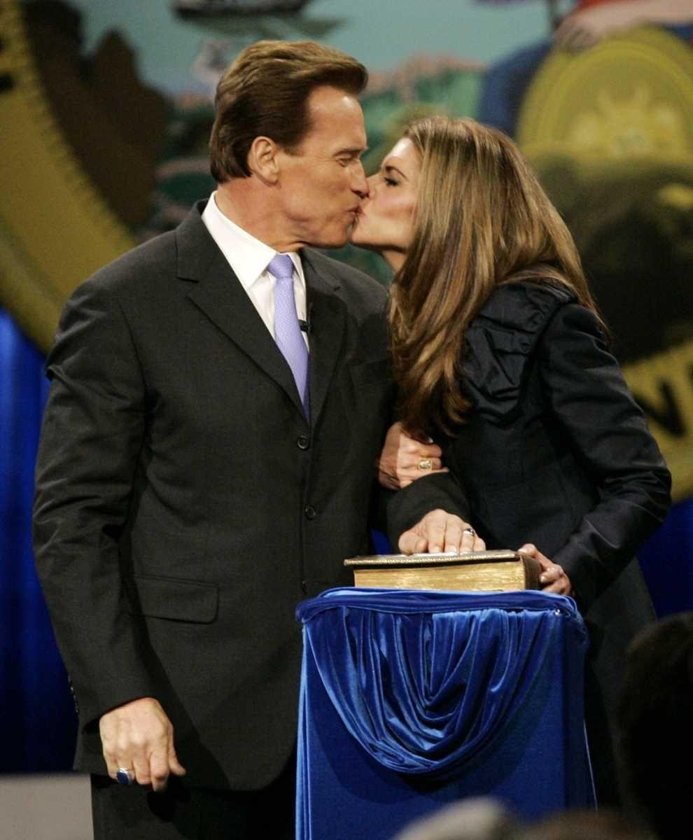 California Gov. Arnold Schwarzenegger kisses his wife, Maria