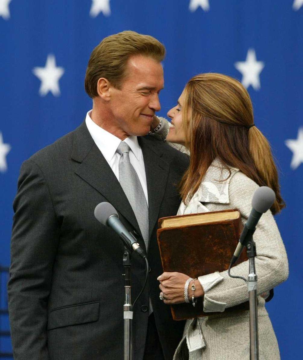 Then-governor Arnold Schwarzenegger kisses his wife, Maria Shriver,