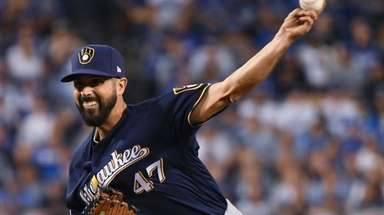 Gio Gonzalez throws during the first inning of