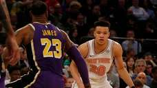 Kevin Knox #20 of the Knicks works against