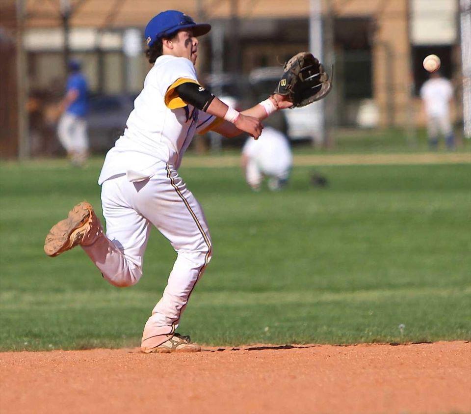 West Islip third baseman Joe Valentine #1 chases