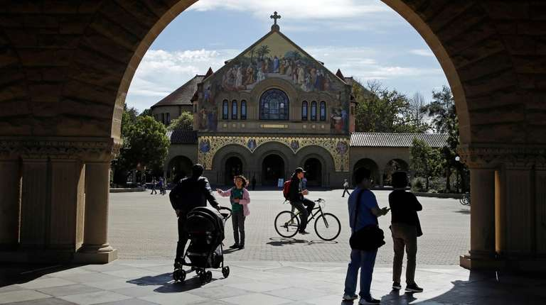 People walk near Memorial Church on the Stanford