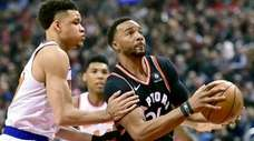 Norman Powell looks for the shot as Kevin