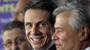 Gov. Andrew Cuomo, center, with from left, Assembly