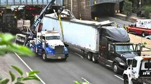 A wayward tractor trailer heading east on the