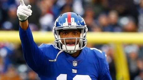 Bennie Fowler of the Giants signals first down