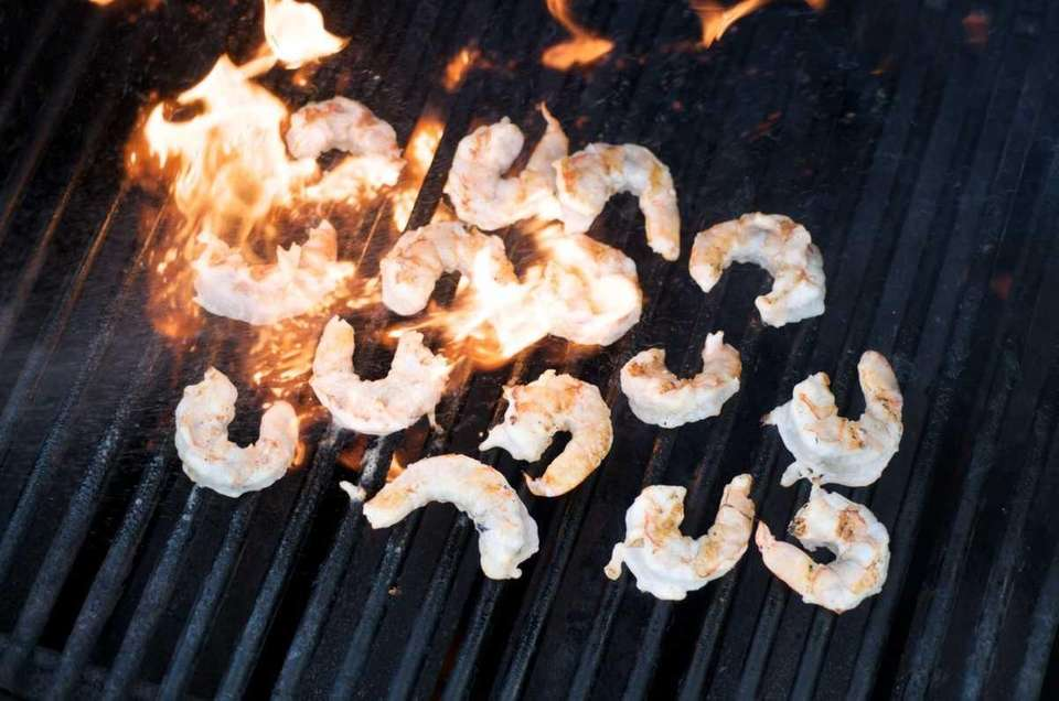Shrimp are grilled over a high flame for